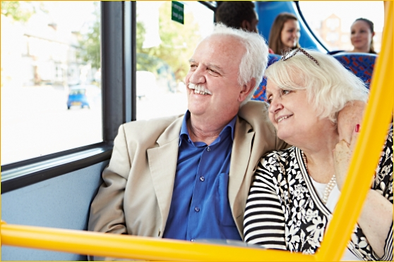 elderly couple on public transit